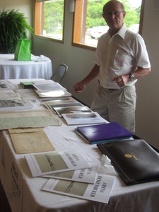 Joe Hodgon helping with books & information on display at the event