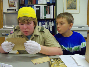 Kasey and Zach checking out a Letter from WWI