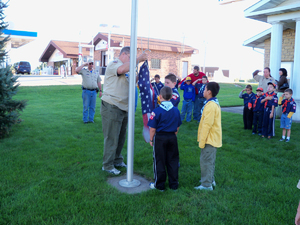 The Cub Scouts raise the flag